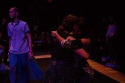 Dancer Samantha Scheller and an audience member dance.