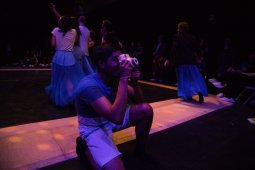 Dancer Radhanath Thialan takes a polaroid of audience members.
